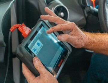 A Pair of Hands Running A Diagnostic Tool