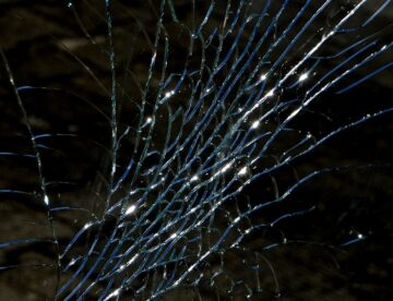 cracked glass depicting a broken windshield