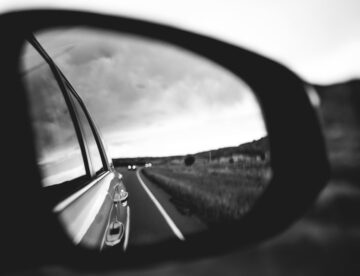 side mirror on the car.
